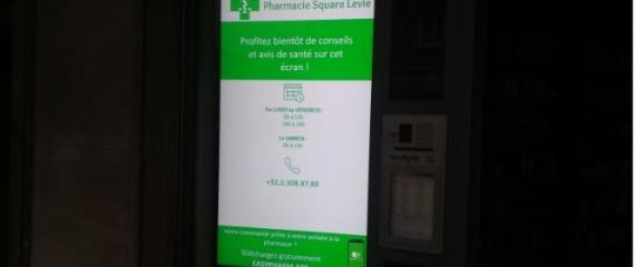 Ecran vitrine haute luminosité et à l'intérieur de la Pharmacie - Bruxelles