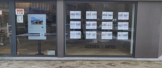 Ecran vitrine pour agence immobilière  à Molenbeek